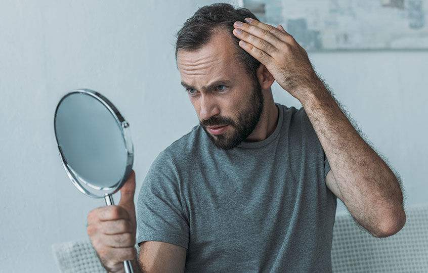 man checking his hair health
