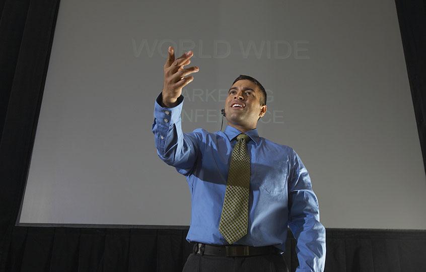 man speaker at conference